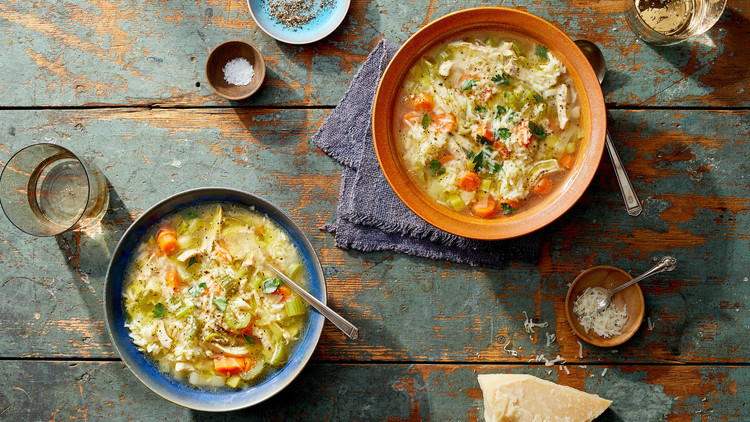 two bowls of chicken soup with rice