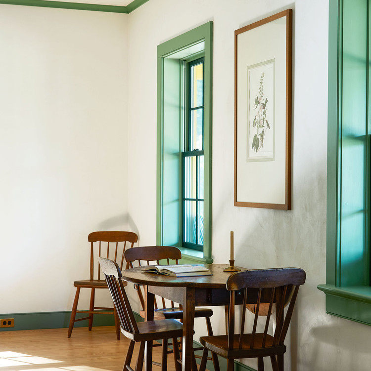 room with walnut drop-leaf table and green accents