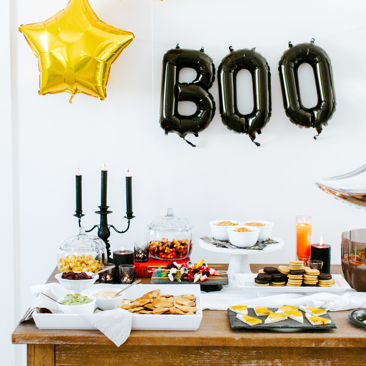 camille styles halloween party table spread food
