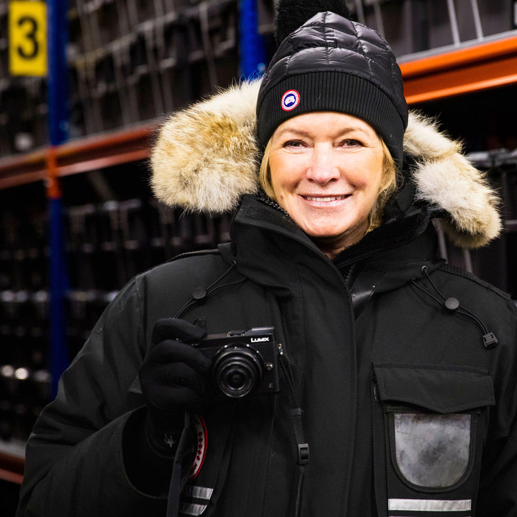 martha wearing winter gear holding camera