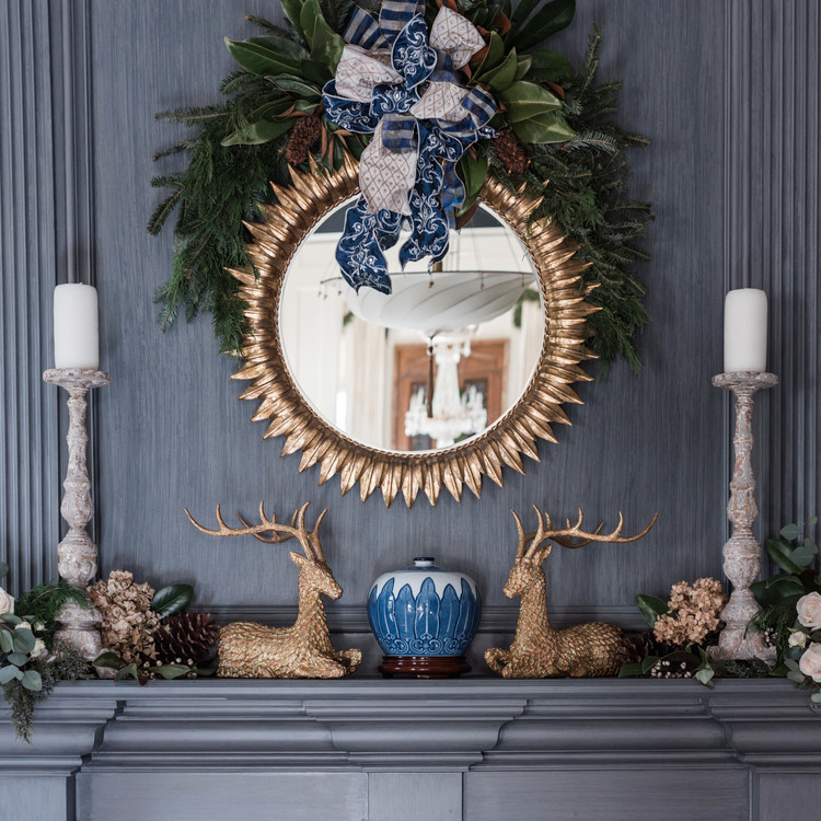 holiday mantle with gold details mirror