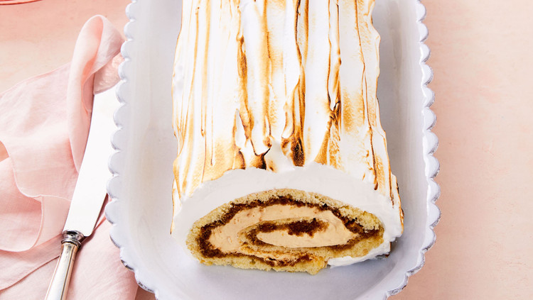 coffee caramel swiss roll on white plate