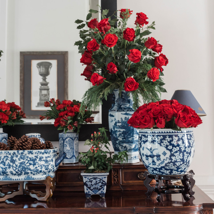 red floral holiday arrangements