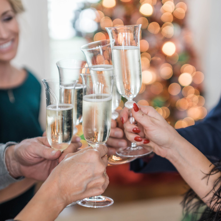 closeup of cheers with champagne flutes