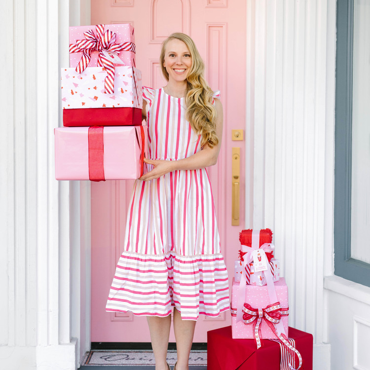 nutcracker christmas party girl with striped dress and pink gifts