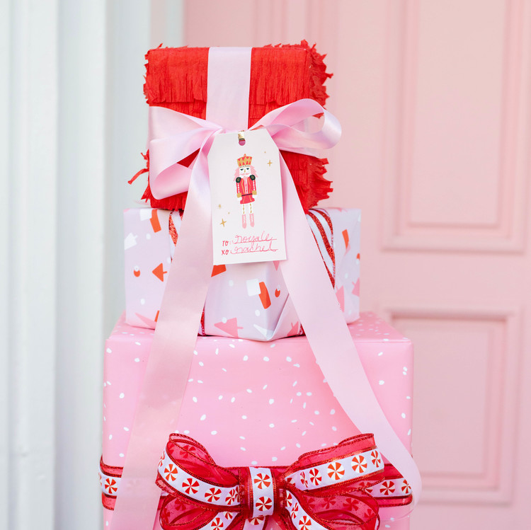 nutcracker christmas party pink white red gift boxes with bows