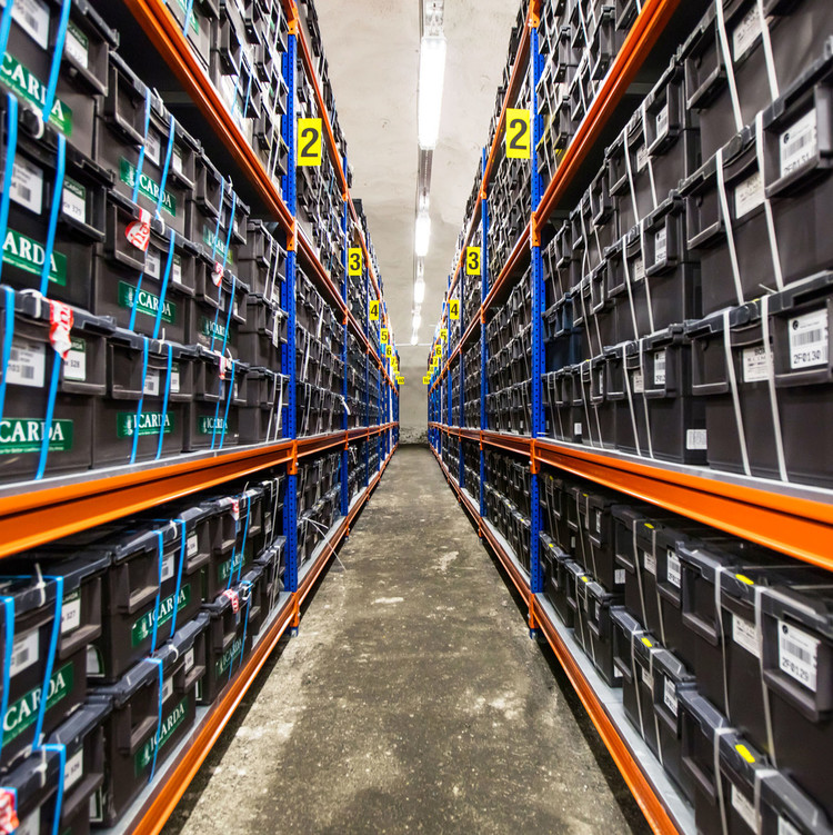 shelves storing sealed containers of seeds