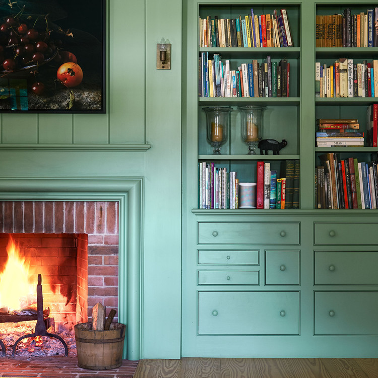 family room with green built-in shelves and fireplace