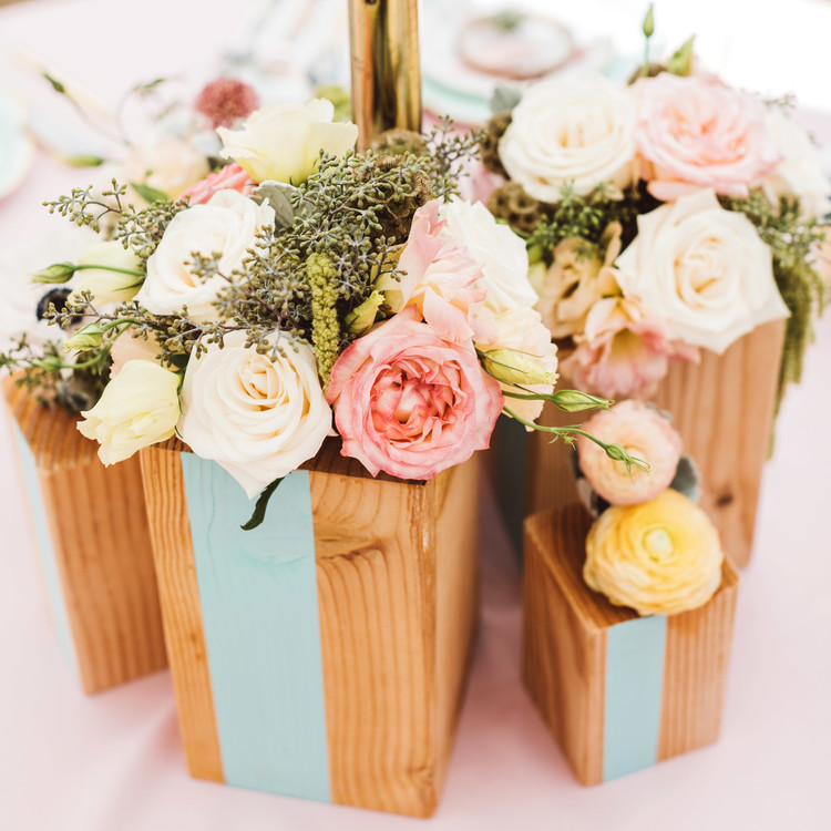 mint blush baby shower flowers centerpieces on tables