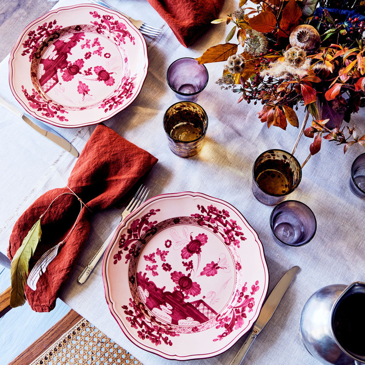 thanksgiving table setting with red floral plates