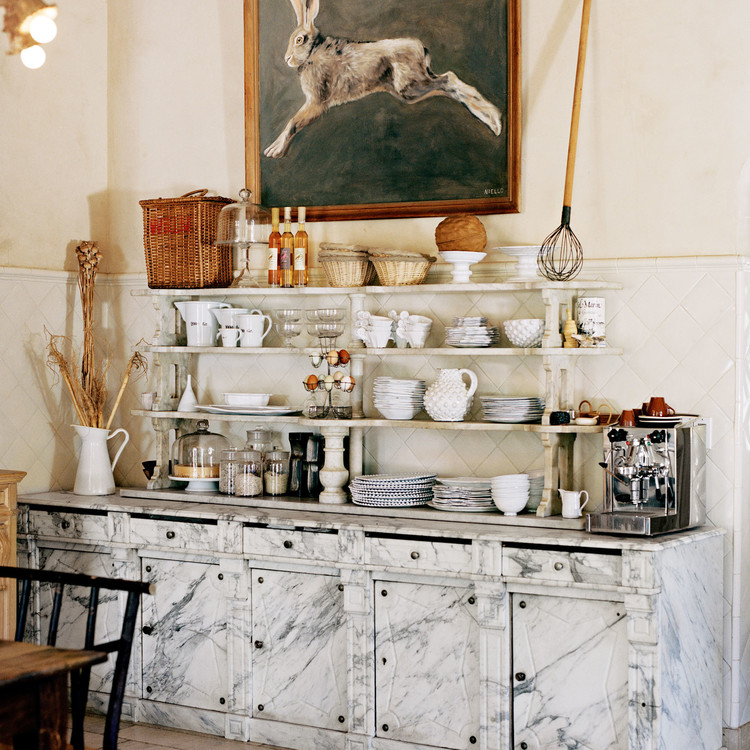 kitchen with marble cabinets open shelving rabbit painting