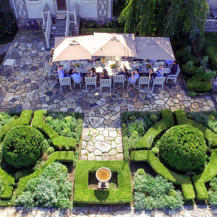 guests waving in drone shot of marthas patio