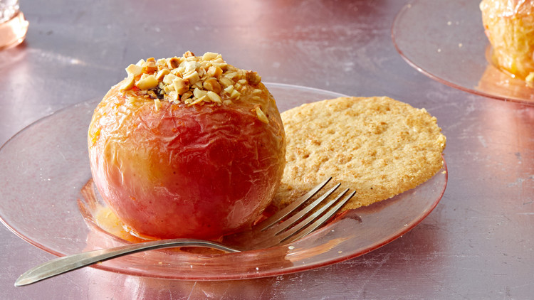 baked apples with cookie on plate