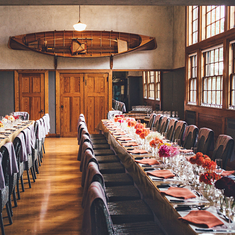long tables at dinner party in acadia carriage house