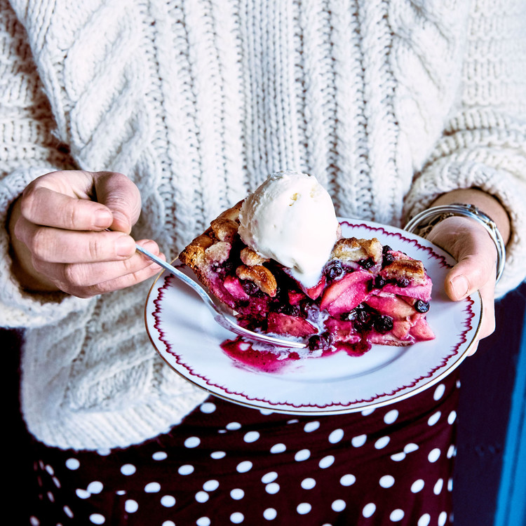 woman with slice of wild maine blueberry and apple pie