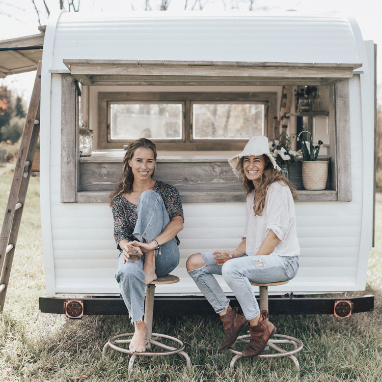 jayson and laura grabe sitting by mobile caravan bar