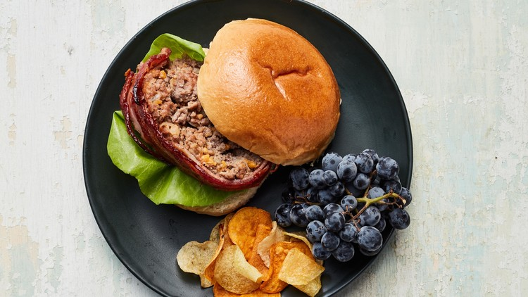 bacon cheeseburger meatloaf plated with grapes and chips