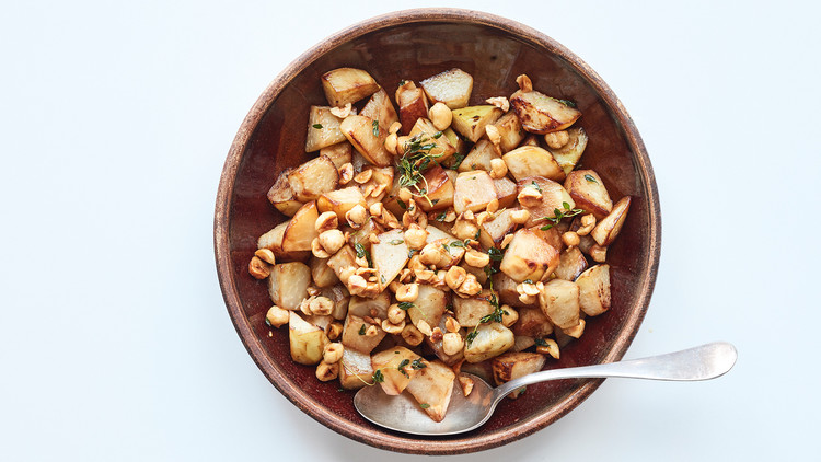 roasted kohlrabi with buttered hazelnuts in brown bowl
