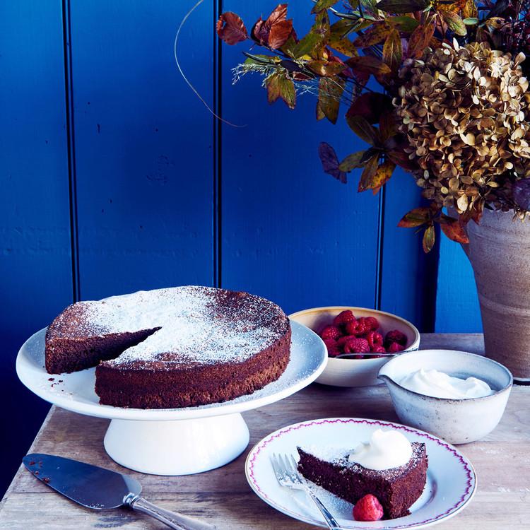 flourless chocolate-almond cake against blue wall